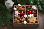 Wooden box with Christmas symbols and spruce branches — Stock Photo