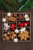 Wooden box with Christmas symbols and spruce branches, top view — Stock Photo