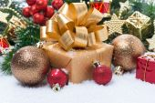 Golden gift box and Christmas tree decorations — Stock Photo