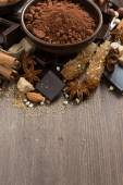Spices for hot chocolate on a wooden background, vertical — Photo