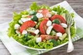Green salad with vegetables and feta on a plate — Stock Photo