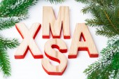 Christmas background with fir branches and wooden letters — ストック写真