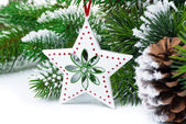 Christmas decorations on a background of fir branches — Stock Photo