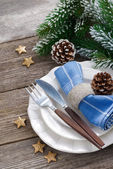 Christmas table setting with spruce branches — Stock Photo