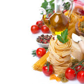 Italian pasta nests, vegetables, spices, olive oil, isolated — Stock Photo