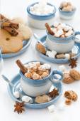 Two cups of cocoa with marshmallows and cinnamon, top view — Stock Photo