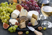 Assorted soft delicacy cheeses and snacks for wine — Stock Photo