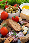 Assortment of delicious antipasti, close-up vertical — Stock Photo