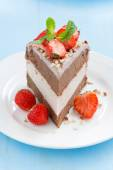 Piece of chocolate cake of three layers with fresh strawberries  — Stock Photo