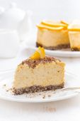Piece of orange cheesecake on a plate, vertical — Stockfoto