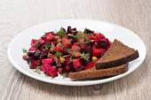 Russian beetroot  salad with bread - vinaigrette — Stock Photo