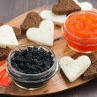 Festive appetizer - toasts, red and black caviar — Stock Photo #60824173