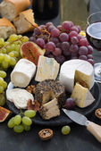 Assorted soft delicacy cheeses and appetizers to wine, top view — Stock Photo