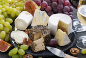 Assorted soft delicacy cheeses and appetizers to wine — Stock Photo