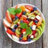 Fruit and berry salad, top view, close-up — Stock Photo