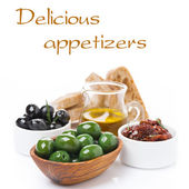 Green and black olives, sun-dried tomatoes, jar with olive oil — Stock Photo