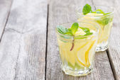Refreshing mint lemonade on a wooden table, space for your text — Stock fotografie