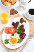 Fried eggs in the form of heart for breakfast Valentine's Day — Stock Photo