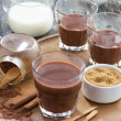 Cocoa in a glass on a wooden tray, vertical — Stock Photo #64194351