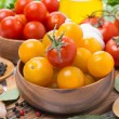 Yellow and red cherry tomatoes in wooden bowls, horizontal — Stock Photo #64616797