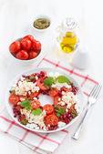 Italian salad with cherry tomatoes, cottage cheese, mint pesto — Stock Photo