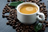 Cup of espresso on coffee beans background, selective focus — Stock Photo