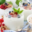Yogurt with fresh berries and breakfast foods on table — Stock Photo #65961921