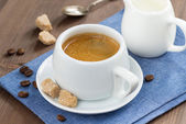 Cup of coffee with sugar and milk jug — Stock Photo