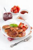 Delicious pancakes with fresh strawberries on a plate, jam and t — Stock Photo