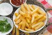 Fried french fries with tomato sauce and herbs, top view — Stock Photo