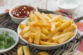 Fried french fries with tomato sauce and herbs — Stock Photo