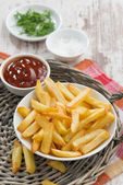 Fried french fries with tomato sauce, vertical — Stock Photo