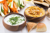 Traditional Arabic sauce - hummus and yogurt with herbs on woode — ストック写真