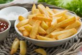 Fried french fries with tomato sauce, close-up — Stock Photo