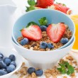 Healthy breakfast - granola, fresh berries and milk on white tab — Stock Photo #70908059
