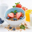 Healthy breakfast - granola, fresh berries and milk on white tab — Stock Photo #70908061