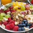 Ingredients for a healthy breakfast - berries, fruit and muesli — Stock Photo #71426811