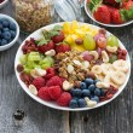 Ingredients for a healthy breakfast - berries, fruit, muesli — Stock Photo #71426929