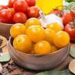 Yellow and red cherry tomatoes in wooden bowls — Stock Photo #72170057