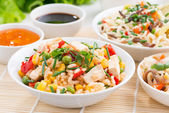 Asian food - fried rice with tofu, noodles with vegetables — Stock Photo