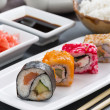 Japanese food - sushi and rolls, vertical — Stock Photo #74829871