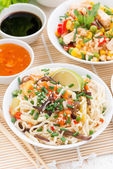 Asian food - noodles with vegetables and greens, fried rice — Stock Photo