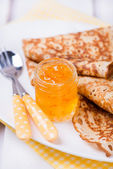 Orange jam with crepes — Stock Photo
