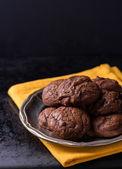 Homemade chocolate cookies on metal plate — Stock Photo