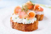 Canapes with smoked salmon and cream cheese — Stock Photo