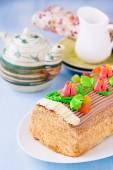 Roulade cake, decorated with colourful buttercream flowers — Stock Photo