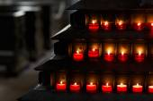 Large group of burning candles at a black background in the chur — Stockfoto