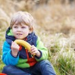 Little toddler boy having picnic near forest lake, nature — Stock Photo #52858543