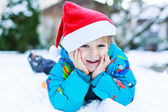 Happy little toddler boy waiting for Christmas santa hat — Stock Photo