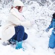 Little preschool boy and his mother playing with first snow in p — Stock Photo #52860931